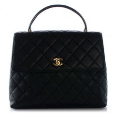 This is an authentic CHANEL Vintage Caviar Kelly Flap in Black.   This stylish vintage Kelly style handbag tote is crafted of luxurious diamond quilted caviar leather.