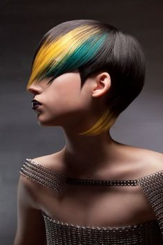 Yellow and dark green highlights. Two contrasting colors can give wonders to dark hair, in this hair coloring style the bright color of yellow is in contrast with dark green and both colors simply jump out of the black hair base color.