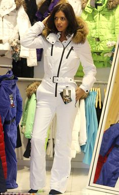Lucy Mecklenburgh reveals slender frame in chic white ski suit