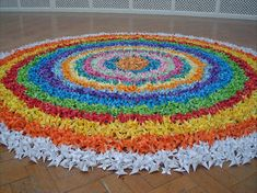Devotion consists of approximately 10,000 origami flowers
