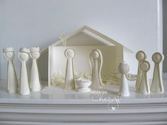 Quilled nativity - picture perfect with a star atop the manger and a little light shining through, giving it a soft glow!