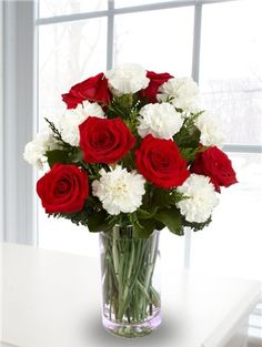 Red rose and white carnation bouquet centerpiece. picture more carnations. waay more carnations.