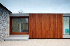 Modern addition set against older existing house.  Well done!