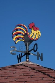 Colorful weather vane on a roof. Nice!