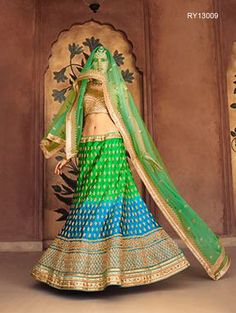 Buy Designer Bridal Lehengas, Wedding Lehengas Online : Give an aesthetic feel to your ethnic look by wearing this green and blue satin unstitched lehenga choli featuring zari work. Paired with a matching dupatta. It can be customized upto size 42. *Call / Whatsapp / Viber : +91-9052526627 *Email : customercare@natashacouture.com *Worldwide Shipping | Free shipping in India | Cash on delivery *