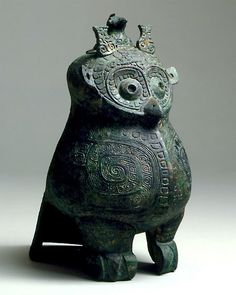 Archaic Owl-Shaped Bronze Covered Ritual Wine Vessel, Shang dynasty, 12th - 11th century BC, H. 21 cm