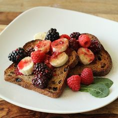 "Sprouted grain organic ""ezekiel"" bread. More nutritious than brown bread and pretty much the only bread I eat. This one is raisin cinnamon! Topped off with some bananas, and berry sauce made with just coconut oil and sweet apple cider."