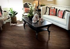 Dark hardwood laminate flooring for living room with white sofa and black table
