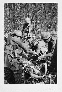 """November 8, 1965         While conducting Operation Hump, companies B and C of the 1/503 of the 173d Airborne, contact the enemy near Hill 65. A multibattalion Viet Cong force attacks at close quarters and forces the Americans into a tight defensive perimeter. Hand-to-hand combat ensues as the enemy """"hugs"""" the American troops to prevent the delivery of supporting air and artillery fire. Medevac teams are scrambled from Tan Son Hut and Bien Hoa at 1230 (at which point over 100 casualties have..."""