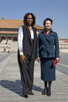 Michelle Obama in 3.1 Phillip Lim and Peng Liyuan [Photo By Andy Wong-Pool/Getty Images]