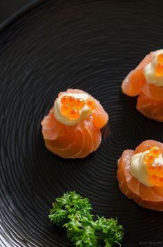 1. Slice the salmon 0.5 cm thick  2. Wrap two slices of salmon around each other to form a circle like sushi. Then put a dollop of Japanese mayonnaise on top of the fish.  3. To serve, spoon a tsp of fresh salmon caviar and let it sit firmly on the mayonnaise. Eat whileit's still fresh and cold.