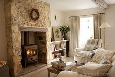 Excellent Absolutely Free Stone Fireplace with stove Style I'm really diggin the stone enclosure for the stove! Inglenook Fireplace, Farmhouse Fireplace, Home Fireplace, Living Room With Fireplace, Fireplace Surrounds, Stone Fireplaces, Modern Fireplaces, Cottage Living Rooms, Cottage Interiors
