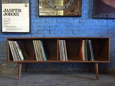 custom made mid century STYLE record cabinet with orange sliding dividers. Made in a sturdy high quality walnut   60.5 x D 14 x H 25.5  $200 is