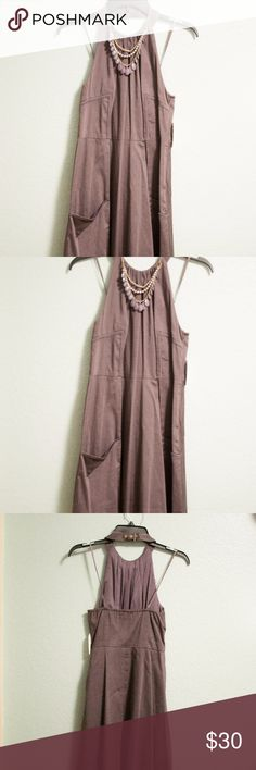 Jessica Simpson Halter Dress NWT, Jessica Simpson gray halter dress with a button clasp around the neck, flares at the bottom and has pockets on each side. Jessica Simpson Dresses Midi