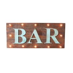 All signs point to the bar when it's football season or at the advent of fall TV premieres. Send a clear message with the Vintage Bar Marquee. The wood and metal sign lights up any lonely corner and brightens up the lounge or bar with vintage school lights.