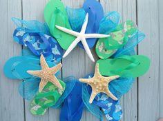 flip flop wreath starfish aqua blue beach lovers beach house nautical beach house decor-- Demi this is cute and probably cheap to make Beach Crafts, Summer Crafts, Diy And Crafts, Arts And Crafts, Recycled Crafts, Driftwood Wreath, Starfish Wreath, Nautical Wreath, Shell Wreath