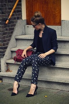 Letting the patterned pants shine with a simple black blazer and tank.
