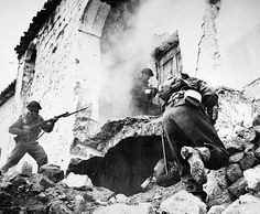 MONTE CASSINO, 1944. New Zealand soldiers search a demolished house for snipers at Cassino, Italy, during World War II. Photographed January 1944.