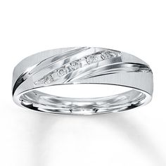 "Think I'm going to get this for my fiance's wedding band. I have the same ""waves"" in my engagement ring"