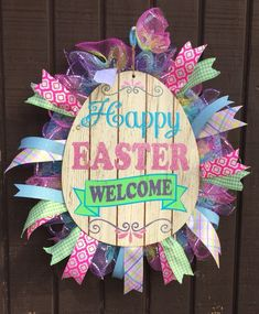 This wooden Easter egg retail is a vintage primitive look to the wooden egg and features deco mesh and ribbon surrounding the centerpiece Deco Mesh Wreaths, 4th Of July Wreath, Easter Eggs, Primitive, Centerpieces, Easter Decor, Halloween, Ribbon, Retail