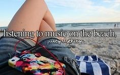 Listening  to music on the beach.