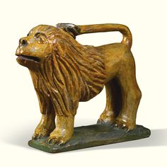 LOT SOLD. $341,000 USD  Wilhelm Schimmel (1817-1890)   LION   Paint on pine  7 3/8 by 7 1/2 by 3 in.  1860-1890  Carved in Cumberland County, Pennsylvania Visual Grace: Important American Folk Art from the Collection of Ralph O. Esmerian