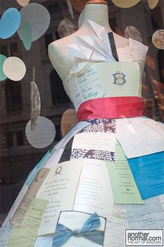 dress made from invitations - window display
