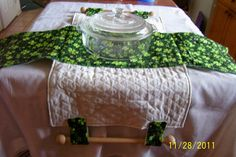 Reversable Cassarole Carrier with wooden handles in green & white shamrock print. $22.00, via Etsy.