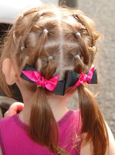 little girls hair style.. I've done this and it's easy. Can also make hair accessories to use by looping tiny rubber band through novelty buttons that have the single loop on the back.  Great to use with this style.