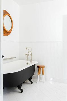 simple bath in black and white with natural wood accents