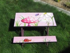 Hand painted children's picnic tables:  My friends makes these!  She is the most amazing artist I have ever met. . .she can paint them in any theme your heart desires!