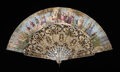 The ornate designs on the sticks and guards of this fan mix Chinese and Western historical motifs.  The birds derive from Chinese forms and the  rococo flower baskets and C-scrolls are taken from the 18th century French design vocabulary