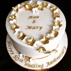 Golden wedding anniversary by Andrea - http://cakesdecor.com/cakes/295436-golden-wedding-anniversary