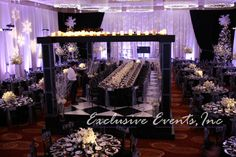 Candle Wall Head Table | Exclusive Events, Inc.  This is a wedding planning co that could be a good resource for you.