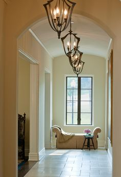 Light fixtures and window. French chateau influence near DC. Barnes Vanze Architects.
