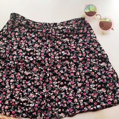 Floral H&M circle skirt Adorable floral skirt, looks super cute with a crop top as pictured. Perfect for spring, or could be adjusted for fall with tights and a sweater. Previously loved, but still in good condition. H&M Skirts Circle & Skater