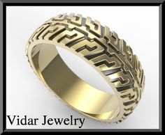 Mens Tire Tread Wedding Ring-Unique Black And by Vidarjewelry. This is gonna be Chris's wedding ring one day when we get married.