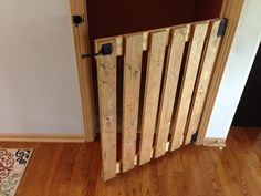 Check out this project on RYOBI Nation - Needed a baby gate for the top of our basement stairs. I took out the existing basement door, and placed a by wooden baby gate. Made from common boards, sanded it down, stained it Golden Oak, screwed it Pallet Crafts, Pallet Projects, Home Projects, Woodworking Projects, Diy Pallet, Pallet Door, Wooden Baby Gates, Diy Baby Gate, Barn Door Baby Gate