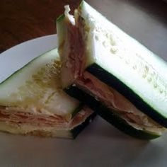 Cucumber chicken subs. Mix shredded chicken breast with cream cheese and dill. Cut cucumber length wise. Easy and healthy!