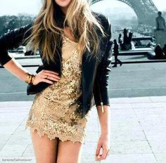 black leather jacket + gold sequin dress + arm candy