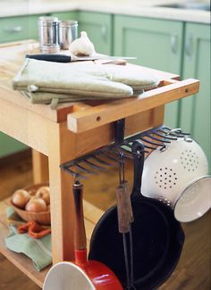 A rake pot rack?! A seriously brilliant idea. i JUST bought an old rake at a yard sale too! only i think i'll use mine for baskets and utensils...