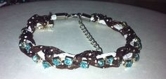 Handmade brown braided leather and rhinestone aqua bracelet.  Perfect for any occasion. on Etsy, $10.00