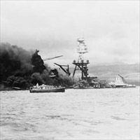 U.S.S. Arizona at height of fire, following Japanese aerial attack on Pearl Harbor, Hawaii.
