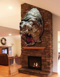 Luke's prized Rancor head over his fireplace.