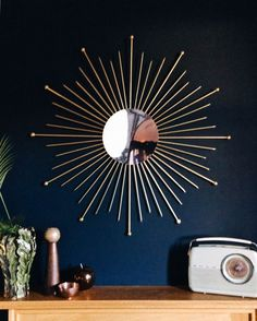 DIY: Sunburst mirror. Make your own stunning mid-century style sunburst mirror with this easy DIY tutorial. It's a cheap and fun way to update a wall.