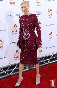 "Tilda Swinton in an off-the-shoulder Schiaparelli dress attends the premiere of ""Snowpiercer"" during the 2014 Los Angeles Film Festival at Regal Cinemas in Los Angeles, California."