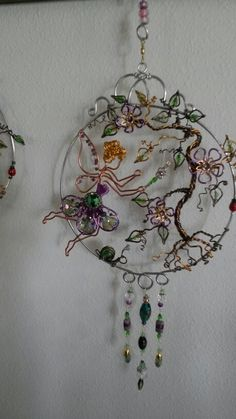 Wire wrapped beaded sun catcher with snail flowers and ladybugs garden fairy.