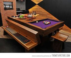 The most luxurious pool table. Not sure it's luxurious, but it's creative. Small spaces do not mean you have to give up all the goodies you would like to have.