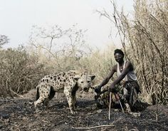 Above Mallam Galadima with Jamis, Nigeria, from 'Gadawan Kura: The Hyena Men II,' Pieter Hugo. (©Pieter Hugo/Courtesy of Steidl). Hyena Man, Hiding In The Bushes, World Press Photo, Amor Animal, Baboon, African History, African Life, West Africa, South Africa