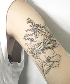 Black and Grey Wild Flower Arm Tattoos to Look Attractive